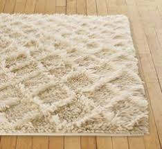 stylish shag rugs for extra comfort in your home ivory shag rug for shag rugs and wood flooring with fluffy rug for charming living room decoration ideas charming shag rugs
