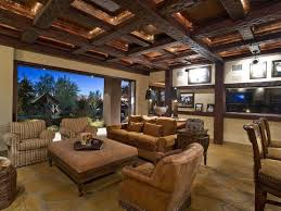 fascinating craftsman living room chairs furniture: plethora of dark wood exposed beams define this living room with open wall to garden