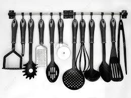 kitchen utensil: stock photo kitchen utensils hanging white background
