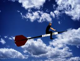 career goals man riding a dart through the sky leadership and sense of purpose concept