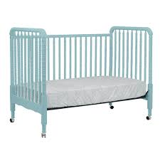 lovely blue davinci jenny lind crib made of wood with wheels for nursery furniture ideas blue nursery furniture