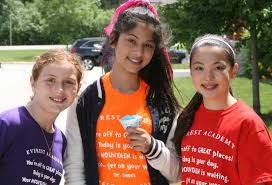 Diana Foran of Homer Glen, with Alia Akoush & Mercedes Patterson of Lemont enjoy snow cones on Everest's last day of school - 532