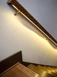 modern lighting ideas that turn the staircase into a centerpiece accent lighting ideas