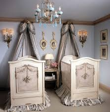 exotic baby room ideas for twin combined with fantastic carved wooden beddings and sweet silver curtains also lovely chandelier plus small round table under baby nursery ideas small