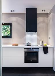 white kitchen windowed partition wall:   white walls black joinery monochrome kitchen