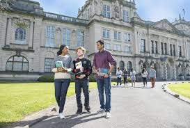 which degree study cardiff university three students outside the university talking and carrying books