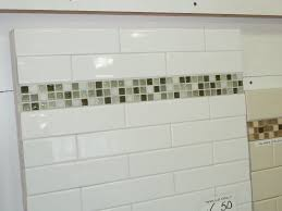 bathroom white tiles:  images about bath ideas on pinterest glass tile shower subway tile showers and dark tile floors