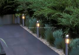 built in step lights and short pole lighting to illuminate garden path in evening amazing garden lighting flower