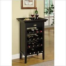 wine cabinet by powell this wine cabinet is the perfect piece for a wine enthusiast crafted with black with merlot rub through finish this cabinet can black mini bar