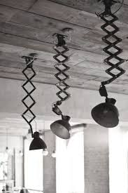 industrial lighting made with acordion type sconce mount multiple on the ceiling and use like ceiling mount track lighting