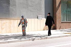 how to keep your job when your boss is a robot gp english robot passes a man on a street man stares