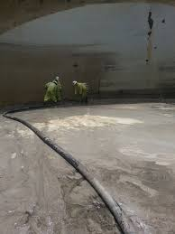 inside a storage tank crews using vacuum truck to remove sludge oil tank cleaning equipment