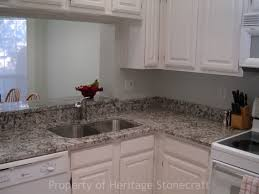 bianco antico granite with white wooden cabinet and lighting lamp also stainless faucet for modern kitchen decor cabinet and lighting