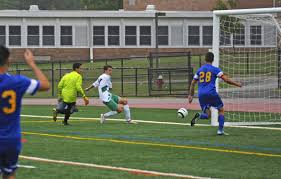 photo essay ridge boys soccer takes command on the field ridge s mark stachowski scoring the first of of 2 goals in s tourney game win 8 1 over manville credits by b bacot aigner