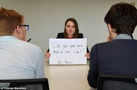the worst job interview questions graduates have been asked    the graduates agreed to pose   placards on which their questions were written  and examples