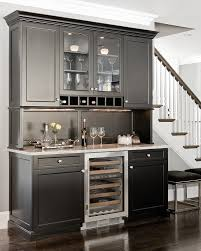 needham bar traditional home bar idea in boston with glass front cabinets black cabinets and granite charming home bar design