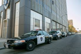 why oakland can t fire bad cops east bay express bert johnson squad cars parked outside of the oakland pd administration building