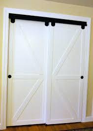 Closet Barn Doors How To Make Bypass Closet Doors Into Sliding Faux Barn Doors