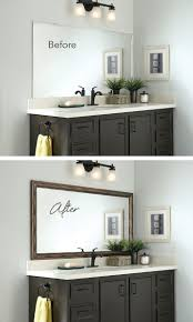 update bathroom mirror: add a mirrormate frame to the mirror while its on the wall for an