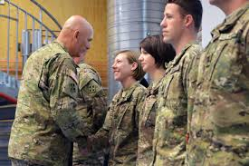 u s department of defense photo essay u s army chief of staff gen ray odierno left presents coins to iers