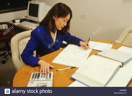 accountant works in office tax forms calculator career asian accountant works in office tax forms calculator career asian female usa math