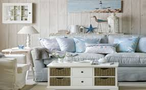 white as well as sandy shades for the living room make use of the wooden coffee table and coastal accessories in order to add to the nautical feeling beach style living room