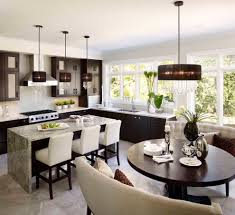 tailored glamour inspiration for a contemporary eat in kitchen remodel in toronto with flat panel cabinets breakfast table lighting