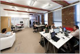london office design peaceful and creative office space idea with white tables exposed brick wall lounge airbnb office london threefold
