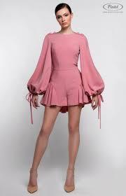 Gently pink <b>mini</b>-jumpsuit with bottom flounce. Tucked long sleeve ...