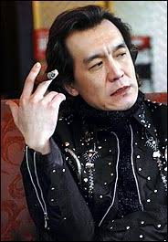 THE third floor of the fashionable coffee shop is empty, so when Li Yong reaches the top of the ... - 21fpro184