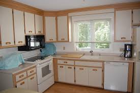 beech wood kitchen cabinets: white brown polished oak kitchen cabinets with doors cabinet has wooden handle and white counter top