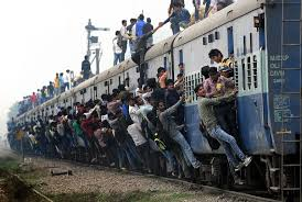 Image result for train india people hanging off