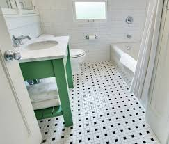 white bathroom floor: white and green bathroom with green washstand and carrara marble countertop over vintage black and white tile floor