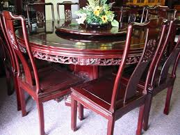 round dining table they are made from the finest woods and are carved with auspicious symbols signifying abundance throughout the year chinese feng shui dining