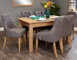 baumhaus mobel oak dining set with 6 stone fabric upholstered chairs baumhaus mobel solid oak reversible