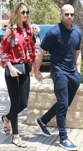Rosie Huntington-Whiteley stuns in floral blouse with Jason Statham ...