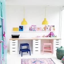 saarkeloves i love everything about your shared kids playroomdesk space the painted stools are awesome the happy yellow lights are fun amazing playroom office shared space