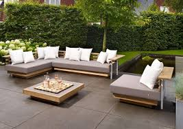 Innovative Patio Pads For Chairs And Low Profile Modern Sectional Sofas Large Square Wooden Coffee Table On Top Of Dark Grey Concrete Paving Slu2026   O