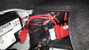 installing a sub stock bmw stereo system wire the positive and negative straight to your battery and hide the wire under the carpet liner