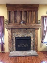 barnwood mantel from reclaimed barn wood timbers veneer stone surround with precast stone hearth barn wood ideas