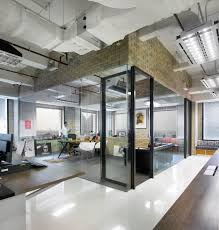 awesome office design awesome and creative office interior with textured stone wall and glass wall and awesome contemporary office design