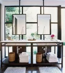 bathroom place vanity contemporary: sleek bathroom design with ceiling mounted hanging mirrors over contemporary double vanity placed in front of floor to ceiling steel windows