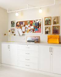 tall built in cabinets for storage doubles as a workstation for art projects built office storage