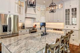 kitchen island granite top sun: elegant kitchen boasts ivory cabinets adorned with oil rubbed bronze hardware and golden irish sun countertops alongside a simple subway tiled backsplash