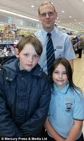 Eight year old girl lands      job      at Aldi after her enthusiastic     Impressed  Store manager Oliver Tingey  pictured with Carrick and Carina  promised to keep