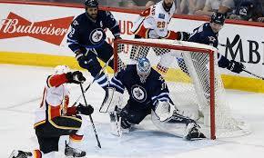 Flames shutout Jets, Senators defeat Avalanche | Daily Mail Online