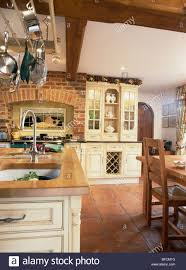 Terra Cotta Tile In Kitchen Terracotta Floor Tiles And Exposed Brick Wall In Country Kitchen
