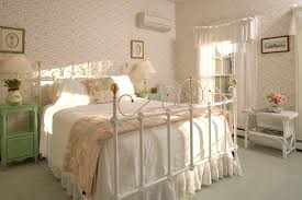 feminine bedroom furniture bed: bedroomidea for country bedroom furniture with wrought iron bed and floral wallpaper country bedroom