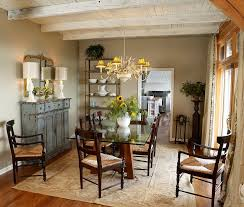 weathered buffet and antique mirror give the cozy dining room a shabby chic look design chic dining room table