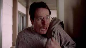 in the first phototaken from the pilot episode of breaking bad this is a screen shot of walter entering his home on his 50th birthday breaking lighting set